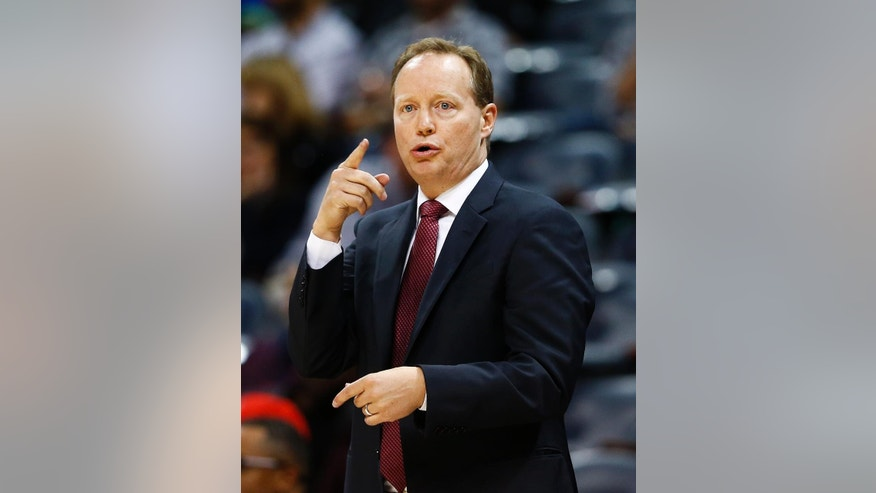 Atlanta Hawks head coach Mike Budenholzer directs his team from the side line in the first half of an preseason NBA basketball game against the New Orleans Pelicans, Monday, Oct. 6, 2014, in Atlanta.  (AP Photo/John Bazemore)