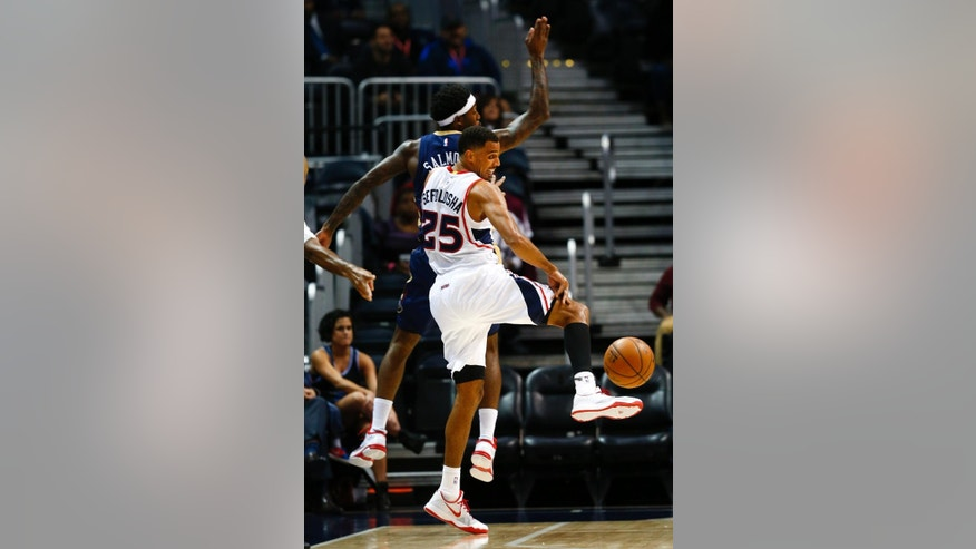 Atlanta Hawks guard Thabo Sefolosha (25) tries to pass against New Orleans Pelicans forward John Salmons (15) in the first half of an preseason NBA basketball game Monday, Oct. 6, 2014, in Atlanta.  (AP Photo/John Bazemore)