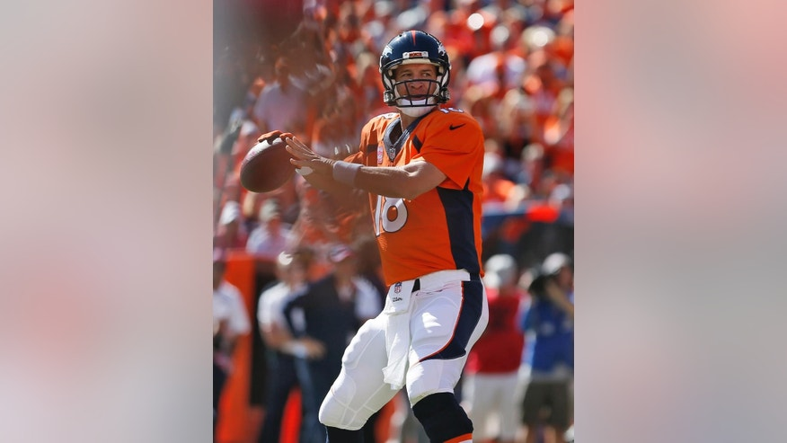 Denver Broncos quarterback Peyton Manning (18) throws his 500th career touchdown pass during the first half of an NFL football game against the Arizona Cardinals, Sunday, Oct. 5, 2014, in Denver. (AP Photo/Joe Mahoney)