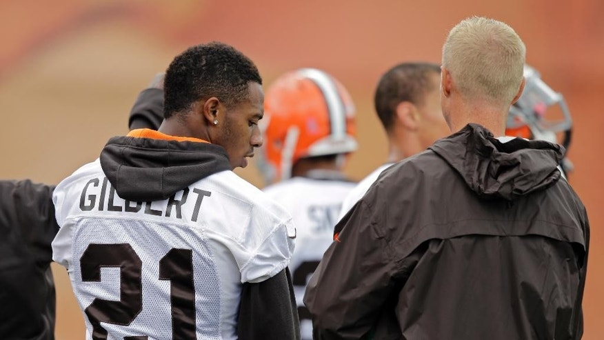 Cleveland Browns cornerback Justin Gilbert (21) waits for a drill to start during practice at the NFL football team's facility in Berea, Ohio Wednesday, Oct. 8, 2014. The rookie cornerback was benched last week at Tennessee and the No. 8 overall pick has had a rough NFL introduction. (AP Photo/Mark Duncan)