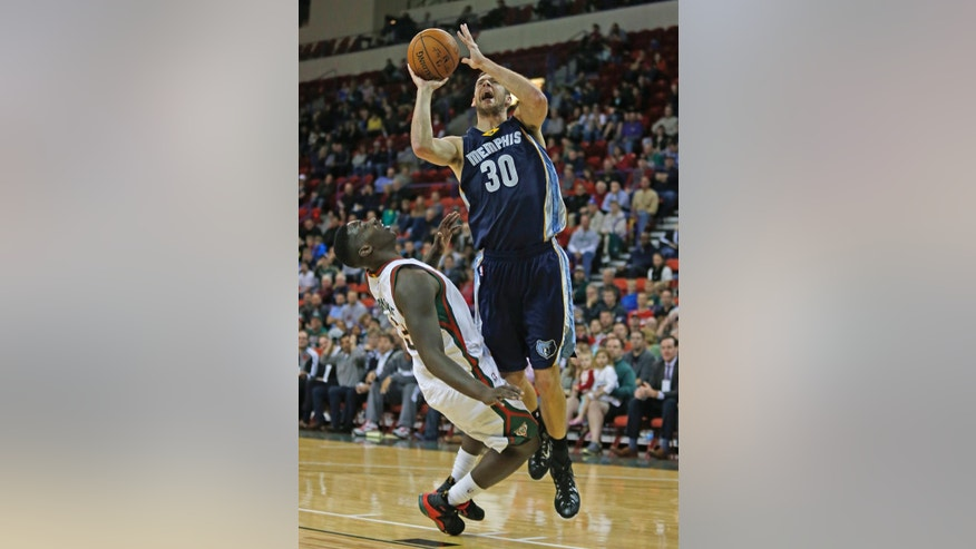 Memphis Grizzlies forward Jon Leuer (30) shoots over Milwaukee Bucks forward Johnny O'Bryant III (3) during the first half of an NBA preseason basketball game Wednesday, Oct. 8, 2014, in Green Bay, Wis. (AP Photo/Matt Ludtke)
