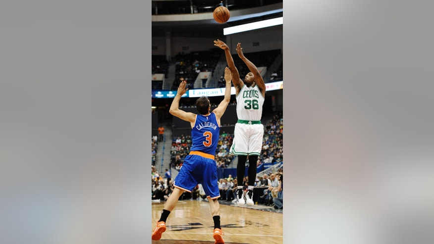 Boston Celtics guard Marcus Smart (36), right, shoots over New York Knicks guard Jose Calderon (3), left, during the second quarter of a preseason NBA basketball game , Wednesday, Oct. 8, 2014, in Hartford, Conn. (AP Photo/Jessica Hill)