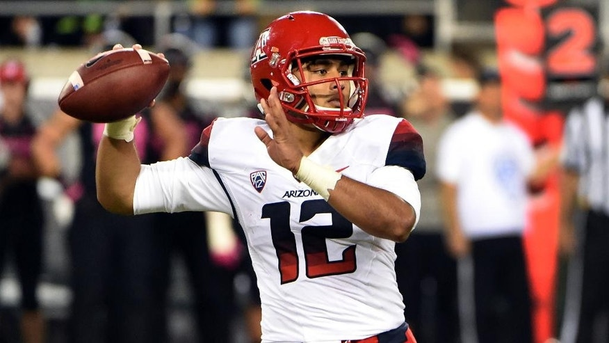 Arizona Wildcats quarterback Anu Solomon (12) passes the ball during the fourth quarter of the NCAA college  football game against Oregon at Autzen Stadium on Thursday, Oct. 2, 2014, in Eugene, Ore. Arizona won the game 31-24. (AP Photo/Steve Dykes)