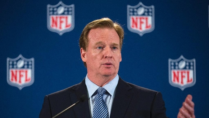 NFL commissioner Roger Goodell speaks during a news conference following a meeting of NFL owners and executives in New York, Wednesday, Oct. 8, 2014. The meetings were held to help the NFL develop and carry out a domestic violence educational program. (AP Photo/John Minchillo)