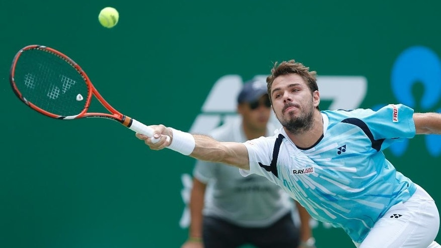 Stan Wawrinka of Switzerland returns a shot against Gilles Simon of France at the Shanghai Masters Tennis Tournament in Shanghai, China, wednesday, Oct. 8, 2014.  (AP Photo/Vincent Thian)