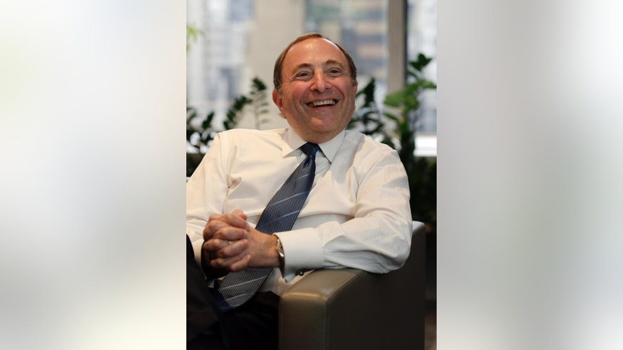 National Hockey League Commissioner Gary Bettman is interviewed in his office, in New York,  Tuesday, Oct. 7, 2014. Bettman is flattered that North American cities without hockey teams are interested in adding one to their towns, but it just isn't in the plans Bettman said Tuesday Oct. 7, 2014 during an interview with The Associated Press. (AP Photo/Richard Drew)