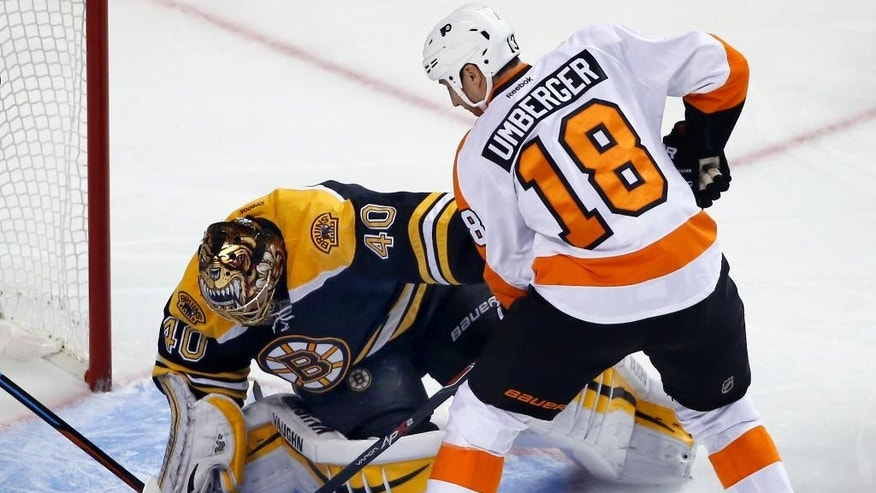Boston Bruins goalie Tuukka Rask (40), of Finland is able to make a save against a scoring bid by Philadelphia Flyers left wing R.J. Umberger (18) in the first period of an NHL hockey game in Boston, Wednesday, Oct. 8, 2014. (AP Photo/Elise Amendola)