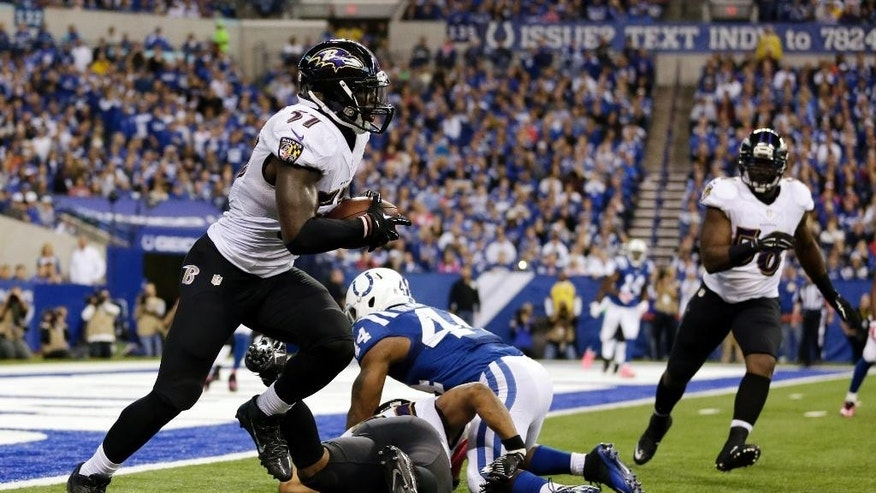Baltimore Ravens inside linebacker C.J. Mosley (57) runs after intercepting a pass by Indianapolis Colts quarterback Andrew Luck during the second half of an NFL football game in Indianapolis, Sunday, Oct. 5, 2014. (AP Photo/Jeff Roberson)