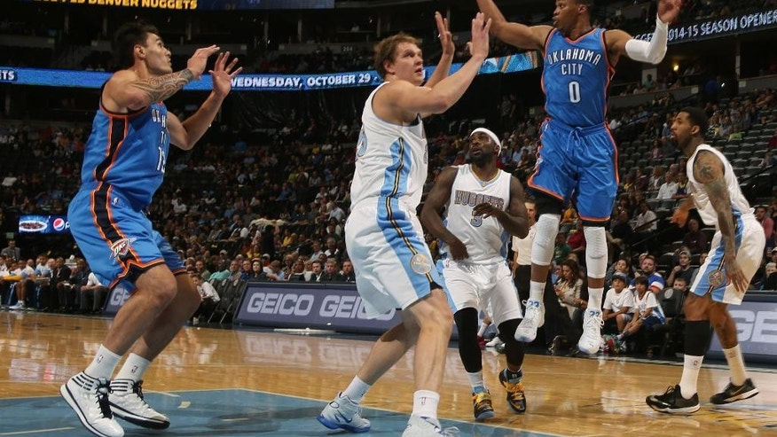 From right, Oklahoma City Thunder guard Russell Westbrook passes ball over Denver Nuggets guard Ty Lawson and center Timofey Mozgov to Thunder forward Steven Adams, of New Zealand, in the first quarter of an NBA exhibition basketball game in Denver on Wednesday, Oct. 8, 2014. (AP Photo/David Zalubowski)