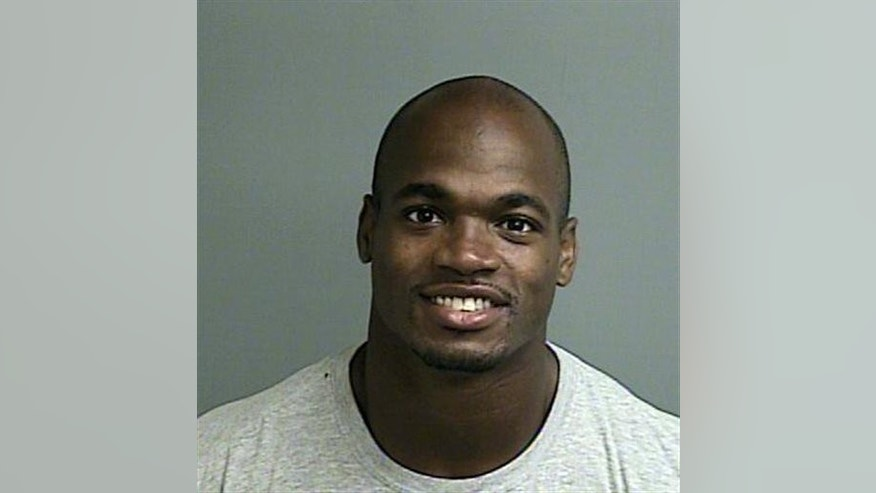 FILE - This photo provided by the Montgomery County sheriff's office shows the booking photo of Adrian Peterson.   Peterson will be in a Texas courtroom Wednesday, OIct. 8, 2014,  for the first time since being indicted last month on a felony child abuse charge. (AP Photo/Montgomery County sheriff's office)