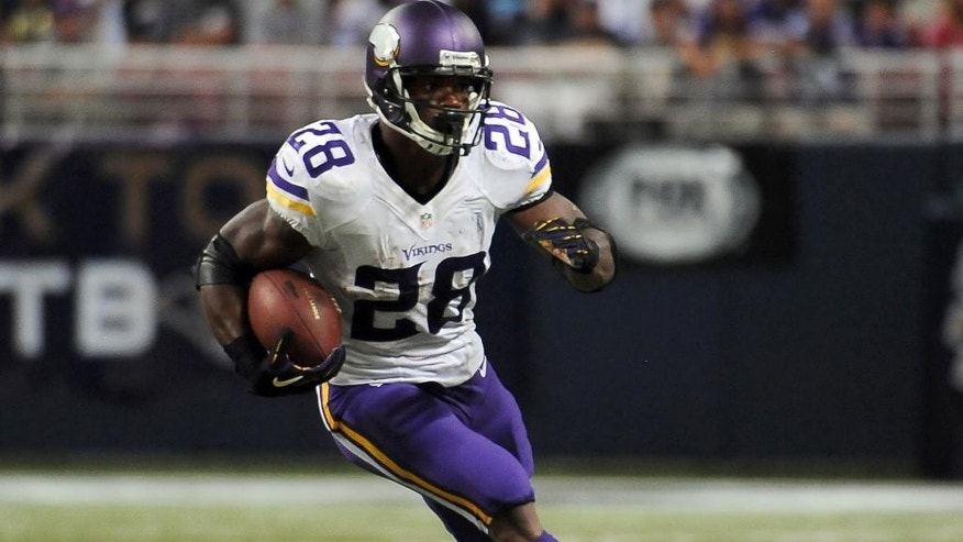 FILE - In a Sept. 7, 2014, file photo Minnesota Vikings running back Adrian Peterson runs with the ball during the second quarter an NFL football game against the St. Louis Rams.   Peterson will be in a Texas courtroom Wednesday Oct. 8, 2014, for the first time since being indicted last month on a felony child abuse charge.(AP Photo/L.G. Patterson, file)