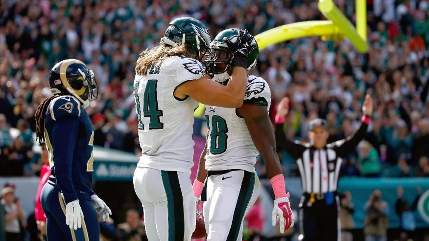 Philadelphia Eagles' Jeremy Maclin, right, and Riley Cooper celebrate after Maclin's touchdown during the second half of an NFL football game against the St. Louis Rams, Sunday, Oct. 5, 2014, in Philadelphia. (AP Photo/Matt Rourke)