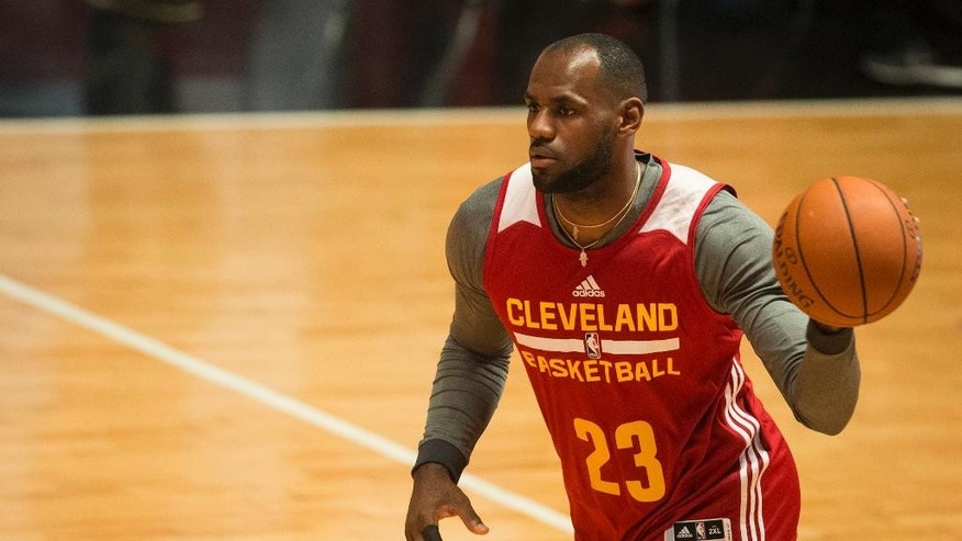 Cleveland Cavaliers' LeBron James dribbles the ball down the court during a training session in Rio de Janeiro, Brazil, Thursday, Oct. 9, 2014. The Cleveland Cavaliers will play the Miami Heat in a preseason game in Rio, on Saturday, as part of the NBA Global Games. (AP Photo/Felipe Dana)