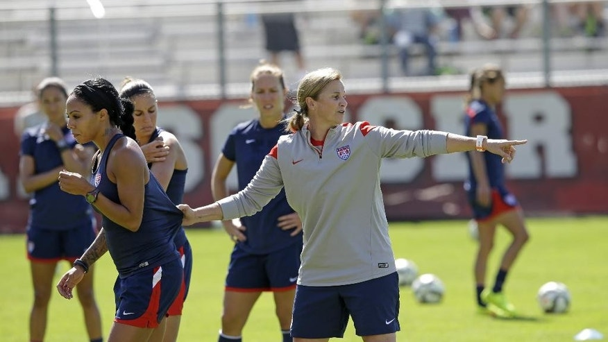 FILE - In this photo Sept. 10, 2014, file photo, U.S. soccer coach Jill Ellis directs U.S. forward Sydney Leroux during practice in Salt Lake City. Five months and a handful of exhibition matches into her job as head coach, Ellis is leading the U.S. national team into next week's CONCACAF championships with a trip to next year's Women's World Cup on the line. (AP Photo/Rick Bowmer, File)