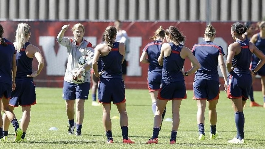 FILE - In this Sept. 10, 2014, file photo, U.S. soccer coach Jill Ellis conducts practice for the U.S. Women's National team, in Salt Lake City. Five months and a handful of exhibition matches into her job as head coach, Ellis is leading the U.S. national team into next week's CONCACAF championships with a trip to next year's Women's World Cup on the line. (AP Photo/Rick Bowmer, File)