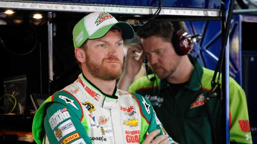 Dale Earnhardt Jr. waits in the garage during practice for Saturday's NASCAR Bank of America Sprint Cup series auto race in Concord, N.C., Thursday, Oct. 9, 2014. (AP Photo/Terry Renna)