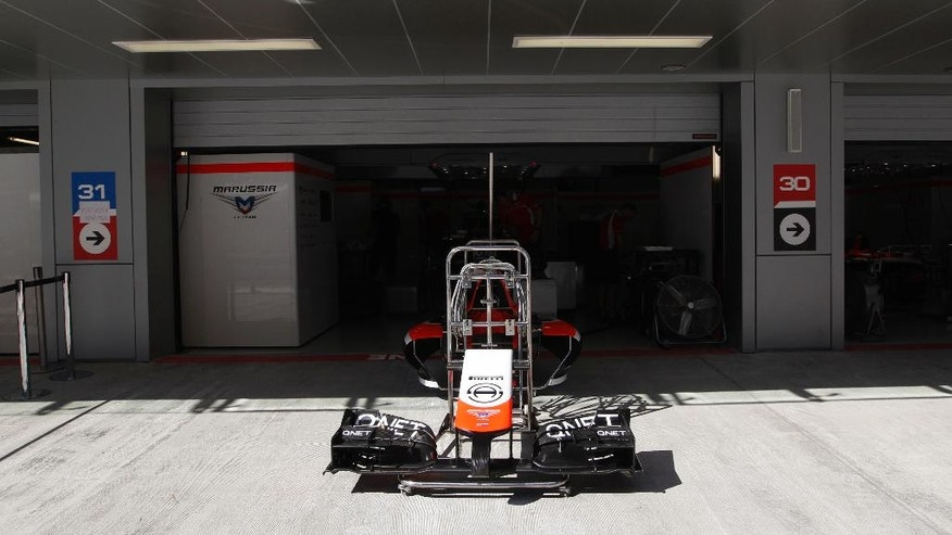 The front fairing of a Marussia car is displayed outside the Marussia Jules Bianchi garage at the Sochi Autodrom Formula One circuit in Sochi, Russia, Thursday, Oct. 9, 2014. Bianchi is in critical but stable condition after suffering a severe head injury when his Marussia car ploughed into a recovery crane at the Suzuka course in Japan during rainy conditions. The inaugural Russian GP will be held on Sunday in Sochi, the Black Sea resort that hosted this year's Winter Olympics. (AP Photo/Luca Bruno)