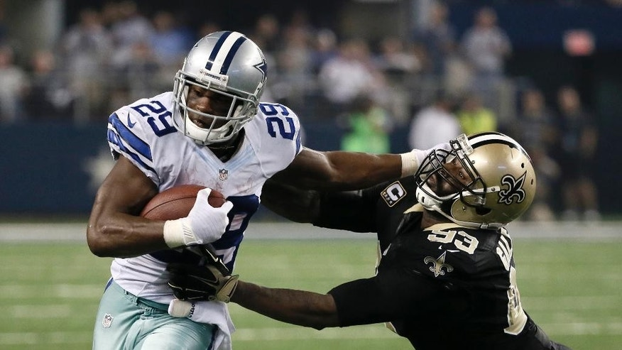 FILE - In this Sept. 28, 2014, file photo, Dallas Cowboys running back DeMarco Murray (29) fights off a tackle attempt by New Orleans Saints' Junior Galette (93) during the second half of an NFL football game in Arlington, Texas. The four straight wins by Dallas ranks near the top among early-season surprises across the league. The Cowboys face the defending champion Seattle Seahawks on Sunday, Oct. 12.  (AP Photo/Brandon Wade, File)