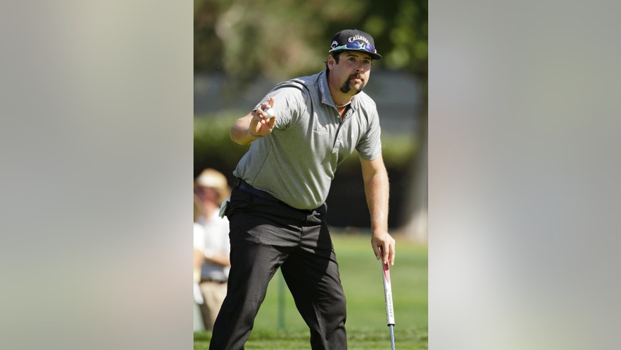 Andres Gonzales holds up his ball after making a birdie putt on the 18th green of the Silverado Resort North Course during the first round of the Frys.com PGA Tour golf tournament Thursday, Oct. 9, 2014, in Napa, Calif. Gonzales shot a 6-under-par 66. (AP Photo/Eric Risberg)