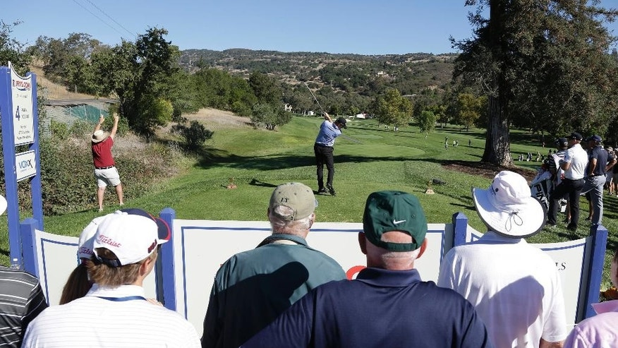 Jimmy Walker hits from the fourth tee of the Silverado Resort North Course during the first round of the Frys.com PGA Tour golf tournament Thursday, Oct. 9, 2014, in Napa, Calif. (AP Photo/Eric Risberg)