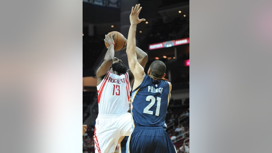 Houston Rockets' James Harden (13) shoots over Memphis Grizzlies' Tayshaun Prince (21) in the first half of an NBA exhibition basketball game Thursday, Oct. 9, 2014, in Houston. (AP Photo/Pat Sullivan)