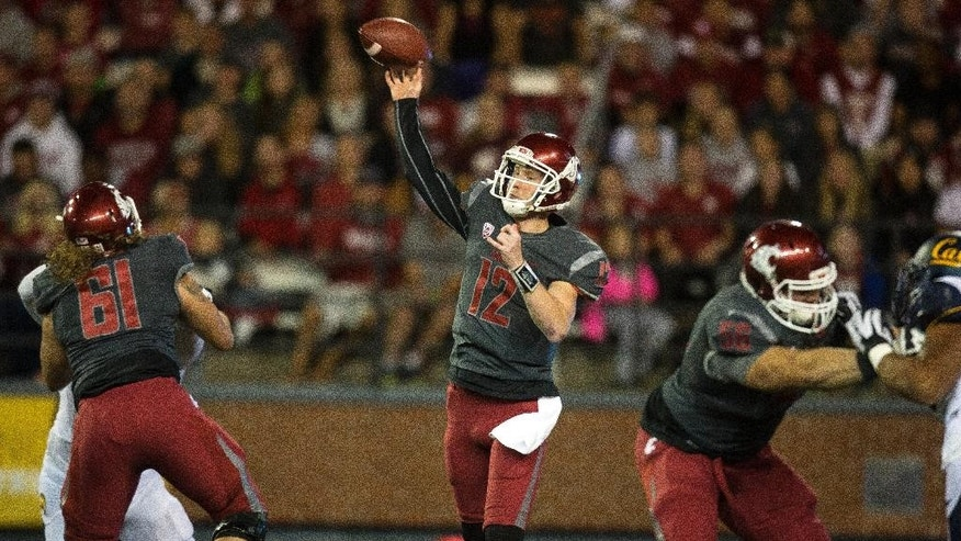 Washington State quarterback Connor Halliday (12) throws a touchdown pass to Vince Mayle against California during the first quarter of an NCAA college football game Saturday, Oct. 4, 2014, at Martin Stadium in Pullman, Wash. (AP Photo/Dean Hare)
