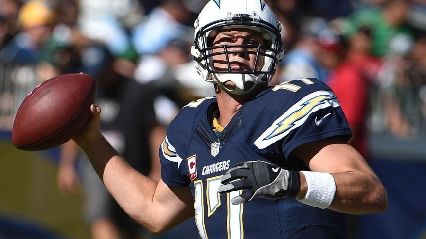 San Diego Chargers quarterback Philip Rivers throws against the New York Jets during the second half of an NFL football game, Sunday, Oct. 5, 2014, in San Diego. (AP Photo/Denis Poroy)