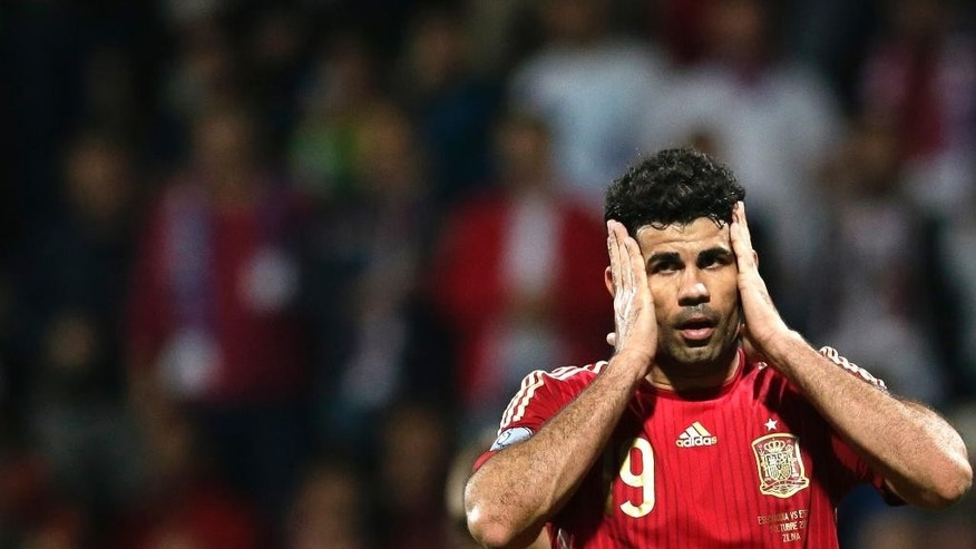 Diego Costa from Spain reacts during the Group C Euro 2016 qualifying match between Slovakia and Spain in Zilina, Slovakia, Thursday, Oct. 9, 2014. (AP Photo/Petr David Josek)