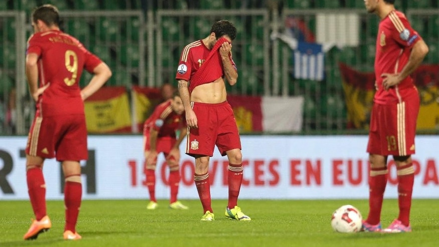Spain's Diego Costa, right, Cesc Fabregas, center, and Paco Alcacer, left, react during the Group C Euro 2016 qualifying match between Slovakia and Spain in Zilina, Slovakia, Thursday, Oct. 9, 2014. (AP Photo/Petr David Josek)