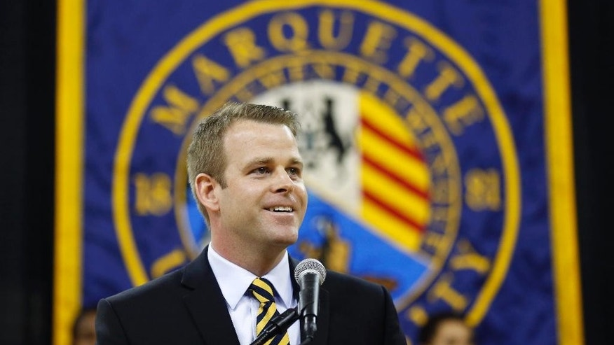 FILE - In this April 1, 2014, file photo, Steve Wojciechowski speaks at a news conference where he was introduced as the new head coach of the Marquette University men's NCAA college basketball team in Milwaukee. Wojciechowski is dealing with a thin roster in training camp as he prepares the team in his first year as head coach. (AP Photo/Jeffrey Phelps)