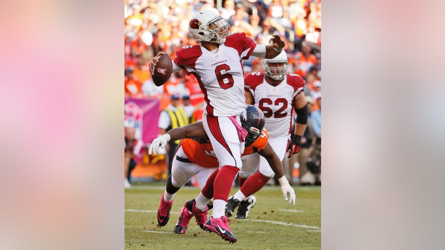 Arizona Cardinals quarterback Logan Thomas (6) throws against the Denver Broncos during the second half of an NFL football game, Sunday, Oct. 5, 2014, in Denver. (AP Photo/Jack Dempsey)