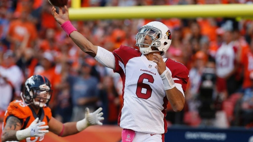 Arizona Cardinals quarterback Logan Thomas (6) throws against  the Denver Broncos during the second half of an NFL football game, Sunday, Oct. 5, 2014, in Denver. The Broncos won 41-20. (AP Photo/Joe Mahoney)