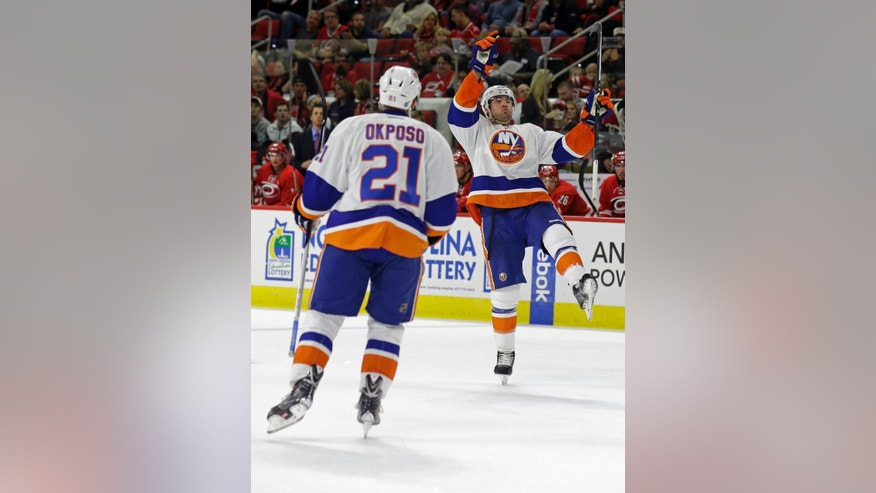 New York Islanders' Johnny Boychuk, right, and Kyle Okposo (21) celebrate following Boychuk's goal against the Carolina Hurricanes during the first period of an NHL hockey game in Raleigh, N.C., Friday, Oct. 10, 2014. (AP Photo/Gerry Broome)