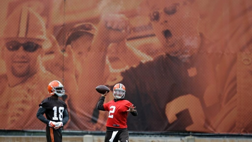 Cleveland Browns quarterback Johnny Manziel (2) fires a pass during practice at the NFL football team's facility in Berea, Ohio Wednesday, Oct. 8, 2014. (AP Photo/Mark Duncan)