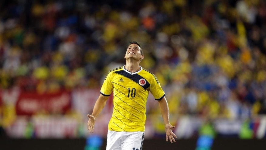 Colombia's James Rodriguez reacts after missing a shot against El Salvador during the second half of an international soccer friendly match at Red Bull Arena, Friday, Oct. 10, 2014, in Harrison, N.J. (AP Photo/Julio Cortez)