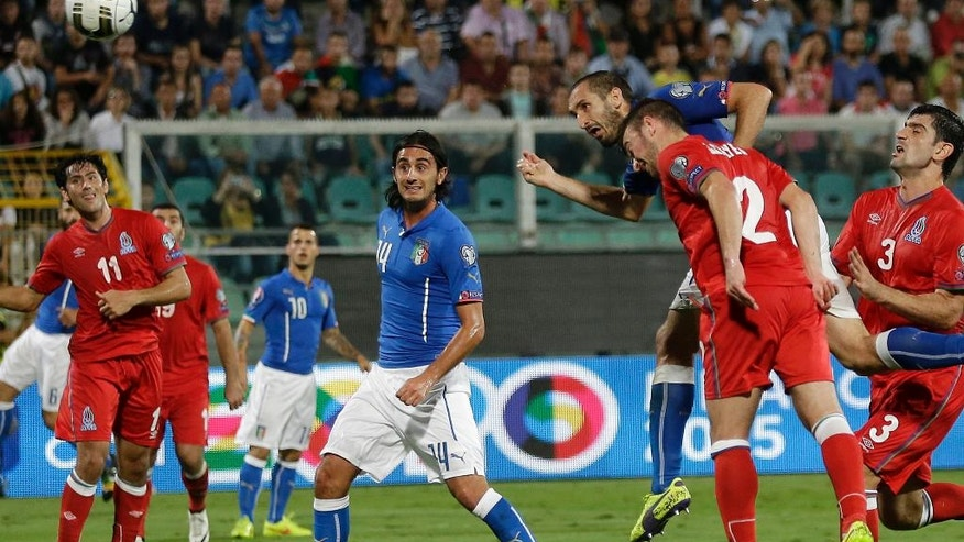 Italy's Giorgio Chiellini, third from right, scores a goal during the Euro 2016 qualifying soccer match between Italy and Azerbaijan, at the La Favorita stadium, in Palermo, Italy, Friday, Oct. 10, 2014. (AP Photo/Antonio Calanni)