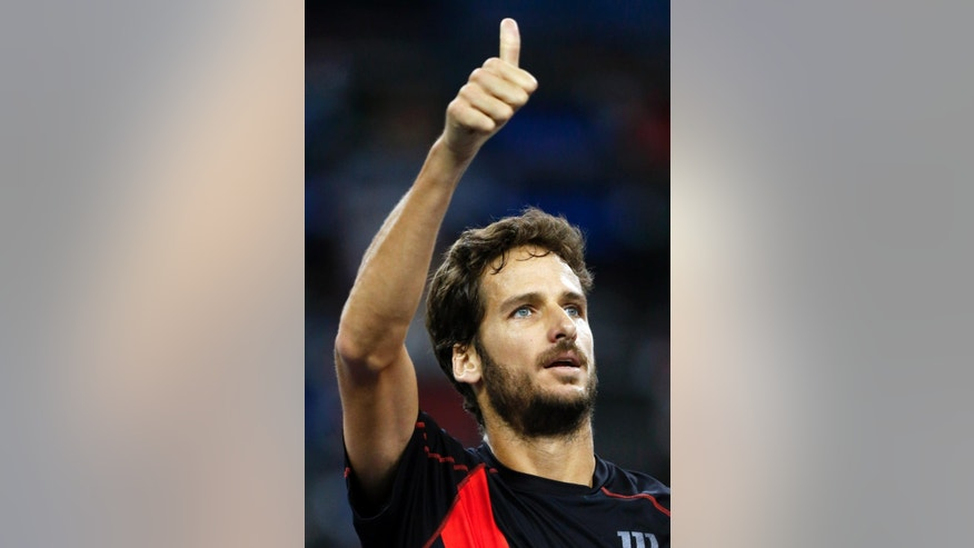 Feliciano Lopez of Spain gives a thumb up sign after he defeated Mikhail Youzhny of Russia during their men's singles quarterfinal match Shanghai Masters Tennis Tournament in Shanghai, China, Friday, Oct. 10, 2014.  (AP Photo/Vincent Thian)