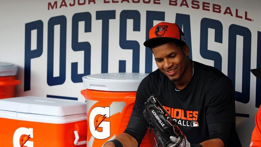 Baltimore Orioles third baseman Jimmy Paredes sits in the dugout before practice for the American League baseball championship series Thursday, Oct. 9, 2014, in Baltimore. The Orioles will play Kansas City Royals starting Friday. (AP Photo/Alex Brandon)