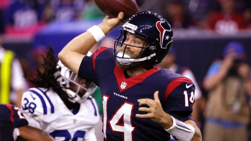 Houston Texans' Ryan Fitzpatrick (14) passes against the Indianapolis Colts during the first quarter of an NFL football game, Thursday, Oct. 9, 2014, in Houston. (AP Photo/David J. Phillip)