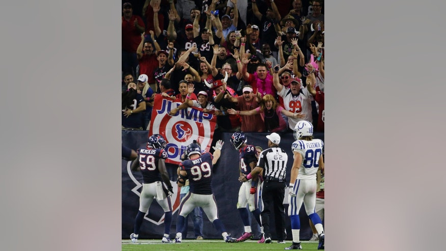 Houston Texans' J.J. Watt (99) celebrates in the end zone after he returned a fumble for a 45-yard touchdown against the Indianapolis Colts during the second half of an NFL football game, Thursday, Oct. 9, 2014, in Houston. (AP Photo/David J. Phillip)