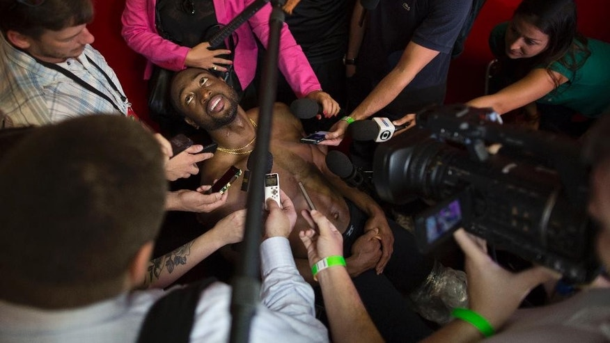 Miami Heat's Dwyane Wade speaks to journalists after a training session in Rio de Janeiro, Brazil, Friday, Oct. 10, 2014. Miami Heat will play Cleveland Cavaliers in a pre-season game on Saturday as part of the NBA Global Games. (AP Photo/Felipe Dana)