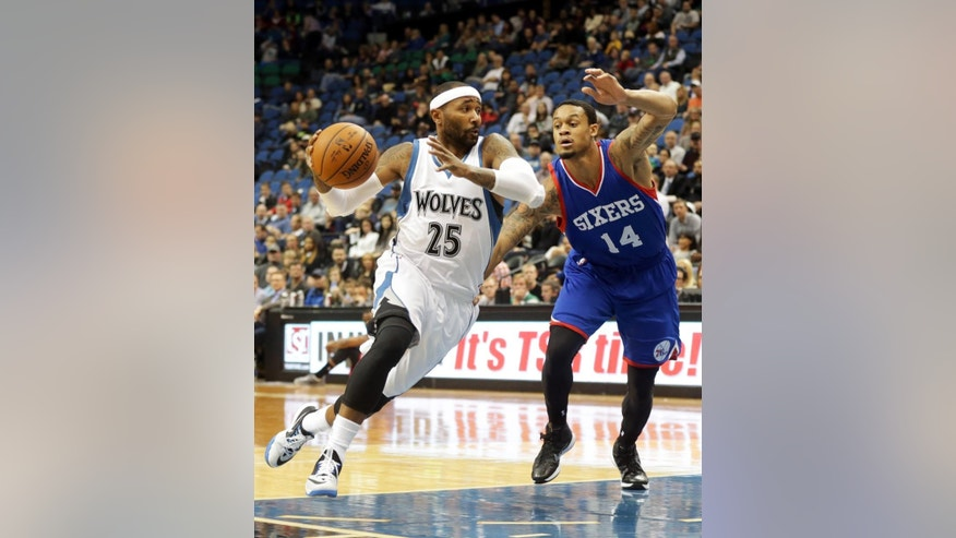 Minnesota Timberwolves guard Mo Williams, left, drives round Philadelphia 76ers' K.J. McDaniels in the first quarter of an NBA preseason basketball game, Friday, Oct. 10, 2014, in Minneapolis. (AP Photo/Jim Mone)
