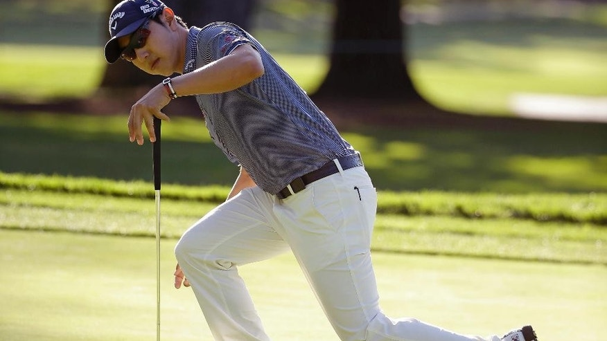 Sang-Moon Bae of South Korea reacts after missing a birdie putt on the seventh green of the Silverado Resort North Course during the first round of the Frys.com PGA Tour golf tournament Thursday, Oct. 9, 2014, in Napa, Calif. (AP Photo/Eric Risberg)