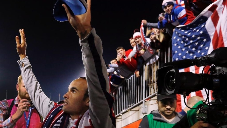 United States' Landon Donovan waves to fans after an exhibition soccer match against Ecuador in East Hartford, Conn., Friday, Oct. 10, 2014. Donovan made his last international soccer appearance. (AP Photo/Elise Amendola)
