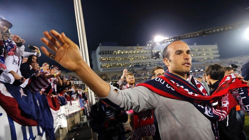 United States' Landon Donovan celebrates with fans after an exhibition soccer match against Ecuador in East Hartford, Conn., Friday, Oct. 10, 2014. Donovan made his last international soccer appearance Friday. (AP Photo/Elise Amendola)