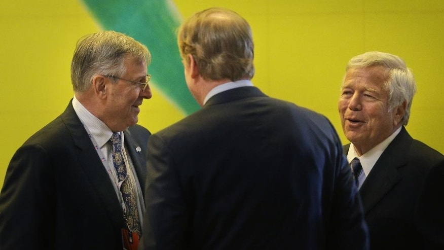 New England Patriots owner Robert Kraft, right, Terry Pegula, who was approved to buy the Buffalo Bills, left, and NFL commissioner Roger Goodell talk during a break in a meeting of NFL owners and executives in New York, Wednesday, Oct. 8, 2014.  (AP Photo/Seth Wenig)
