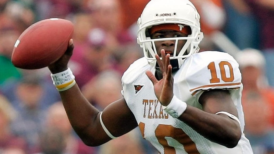 FILE - In this Nov. 25, 2005, file photo, Texas quarterback Vince Young looks to throw a pass against Texas A&M during the first quarter of an NCAA college football game in College Station, Texas. Ahead of the 2014 college football season, The Associated Press asked its panel of Top 25 voters, who are known for ranking the nation's top teams each week, to weigh in on which team during the Bowl Championship Series-era (1998-2013) was the best. Texas placed fourth with Young in 2005. (AP Photo/David J. Phillip, File)