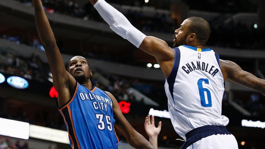 Oklahoma City Thunder forward Kevin Durant (35) shoots in front of Dallas Mavericks center Tyson Chandler (6) during the first half of a preseason NBA basketball game, Friday, Oct. 10, 2014, in Dallas, Texas. (AP Photo/Jim Cowsert)