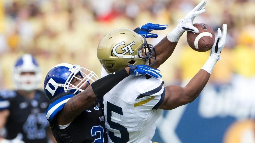 Georgia Tech wide receiver DeAndre Smelter (15) can't hang on to a pass as Duke safety DeVon Edwards (27) defends during the first half of an NCAA college football game Saturday, Oct. 11, 2014, in Atlanta.  (AP Photo/John Bazemore)