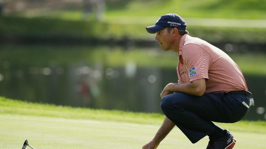Matt Kuchar lines up his putt on the 11th green of the Silverado Resort North Course during the second round of the Frys.com PGA Tour golf tournament Friday, Oct. 10, 2014, in Napa, Calif. (AP Photo/Eric Risberg)